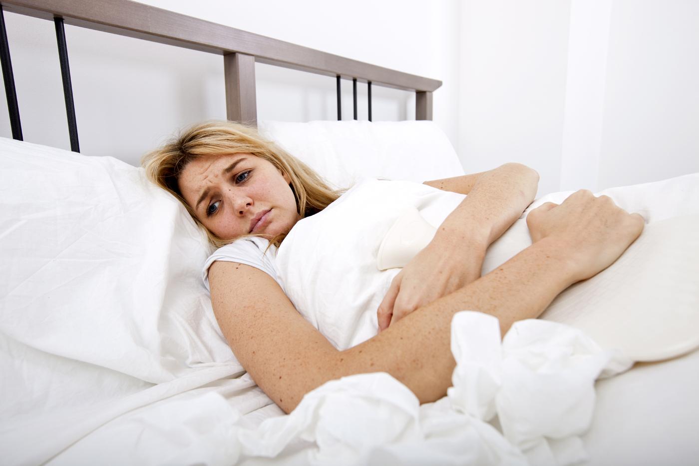 Woman-suffering-from-abdomen-pain-in-bed.jpg
